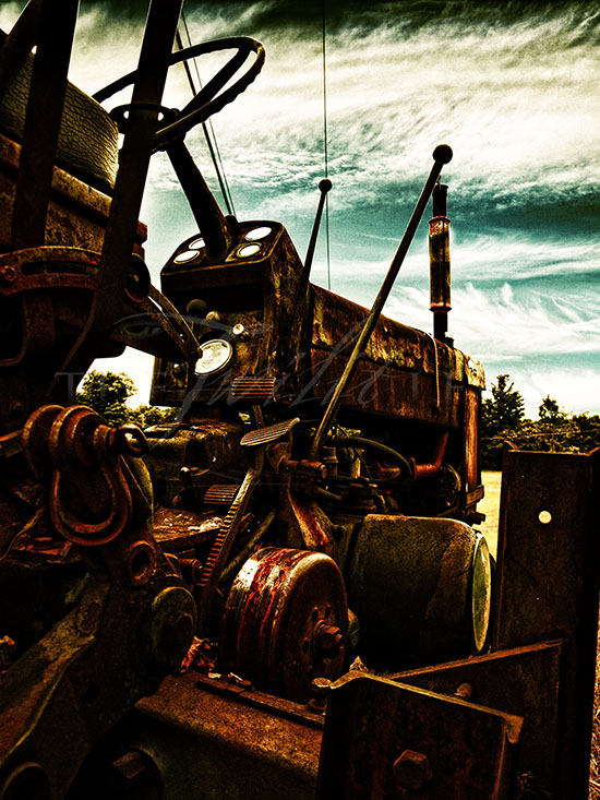 surreal photograph of an abandoned tractor